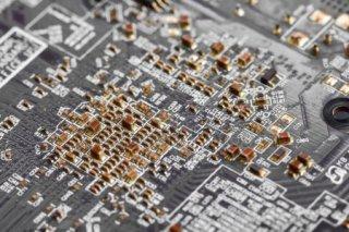 depositphotos_174937256-stock-photo-closeup-electronic-circuit-board-background